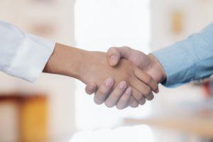 Businessmans handshake after good deal.